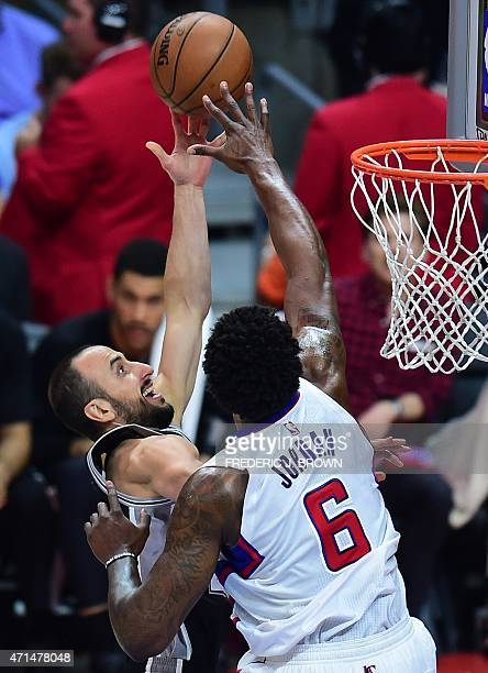 DeAndre Jordan of the Los Angeles Clippers attempts to block a shot from Manu Ginobili of the San Antonio Spurs during Game 5 of their first round...