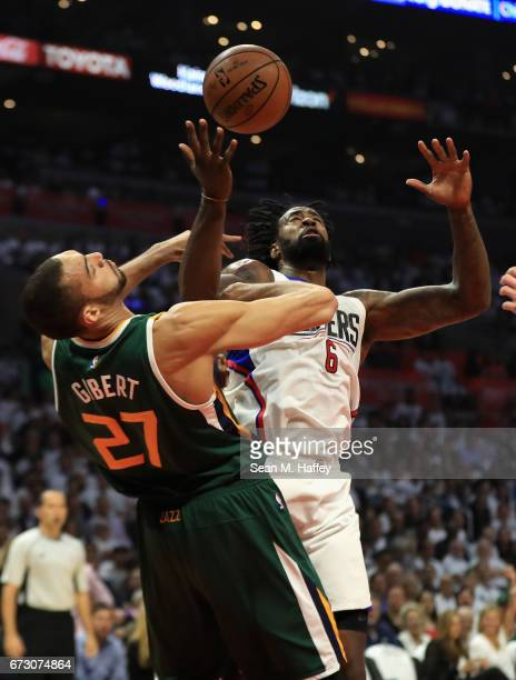 DeAndre Jordan of the Los Angeles Clippers battles Rudy Gobert of the Utah Jazz for a rebound during the first half of Game Five of the Western...