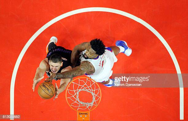 DeAndre Jordan of the Los Angeles Clippers blocks a layup against Alex Len of the Phoenix Suns during the first half of the basketball game at...