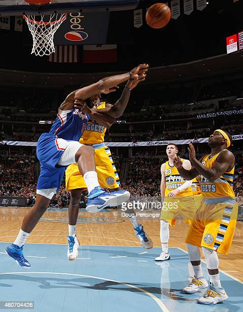 DeAndre Jordan of the Los Angeles Clippers commits a flagrant foul against Kenneth Faried of the Denver Nuggets in the fourth quarter at Pepsi Center...