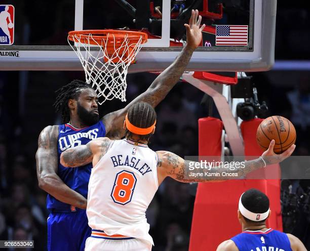 DeAndre Jordan of the Los Angeles Clippers defends a shot by Michael Beasley of the New York Knicks in the first half at Staples Center on March 2...