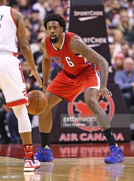 DeAndre Jordan of the Los Angeles Clippers defends against the Toronto Raptors during an NBA game at the Air Canada Centre on January 24 2016 in...