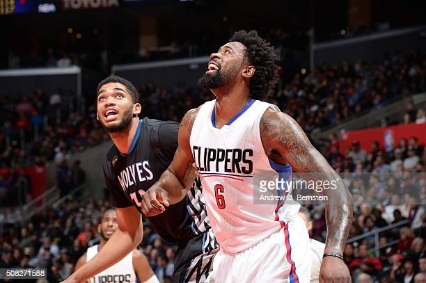 DeAndre Jordan of the Los Angeles Clippers defends the basket against KarlAnthony Towns of the Minnesota Timberwolves during the game on February 3...