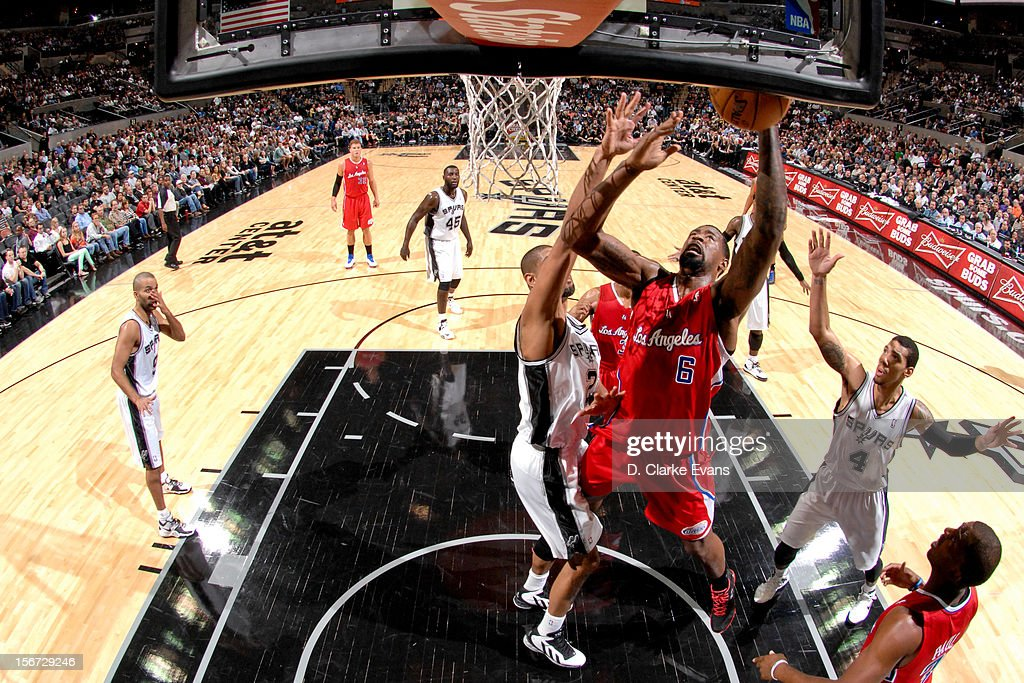 DeAndre Jordan #6 of the Los Angeles Clippers drives to the basket against Tim Duncan #21 of the San Antonio Spurs on November 19, 2012 at the AT&T Center in San Antonio, Texas.