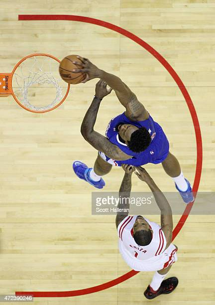 DeAndre Jordan of the Los Angeles Clippers dunks the ball against Trevor Ariza of the Houston Rockets during Game Two in the Western Conference...
