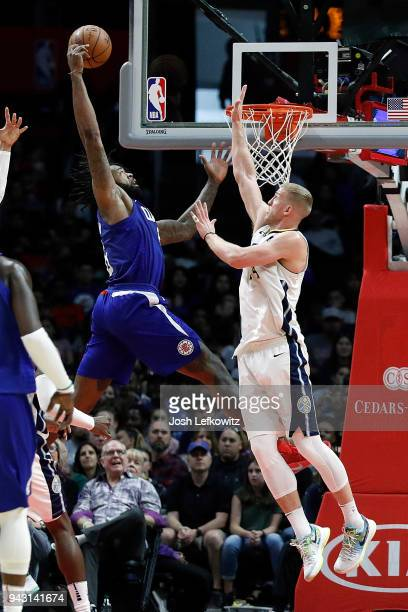 DeAndre Jordan of the Los Angeles Clippers dunks the ball over Mason Plumlee of the Denver Nuggets during the game at the Staples Center on April 7...