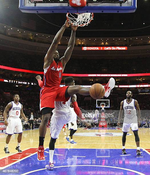DeAndre Jordan of the Los Angeles Clippers dunks the ball over Nerlens Noel of the Philadelphia 76ers on March 27 2015 at the Wells Fargo Center in...