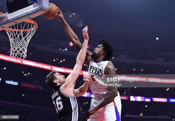 DeAndre Jordan of the Los Angeles Clippers dunks the ball over Pau Gasol of the San Antonio Spurs during the game at Staples Center on December 22...