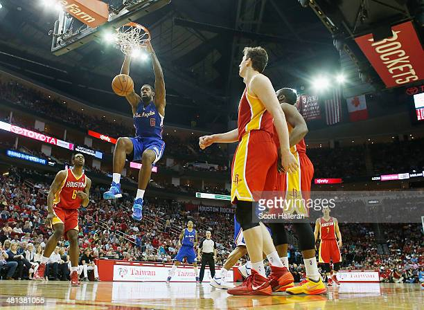 DeAndre Jordan of the Los Angeles Clippers dunks the ball over the Houston Rockets during the game at the Toyota Center on March 29 2014 in Houston...