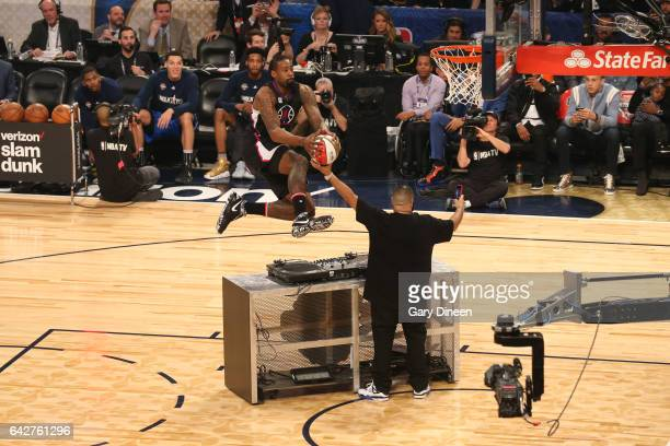 DeAndre Jordan of the Los Angeles Clippers dunks the ball with help from DJ Khaled during the Verizon Slam Dunk Contest during State Farm AllStar...