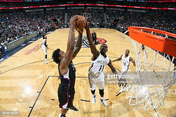 DeAndre Jordan of the Los Angeles Clippers goes for the rebound against Jrue Holiday of the New Orleans Pelicans during the game on March 14 2016 at...
