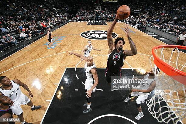 DeAndre Jordan of the Los Angeles Clippers goes up for a dunk against the Brooklyn Nets on December 12 2015 at Barclays Center in Brooklyn New York...