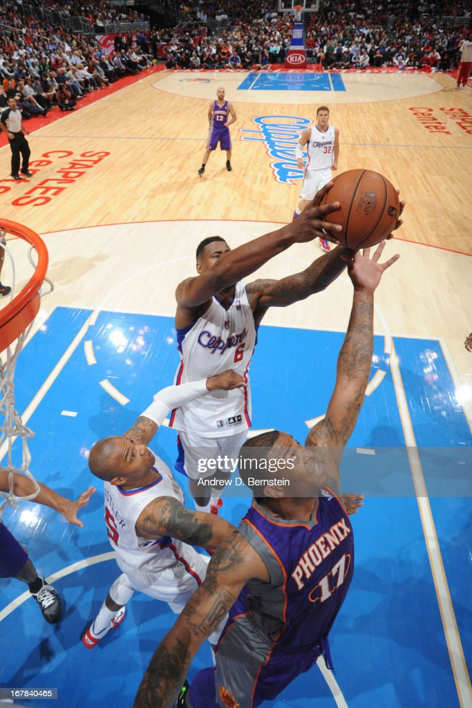 DeAndre Jordan #6 of the Los Angeles Clippers grabs a rebound against the Phoenix Suns Staples Center on April 3, 2013 in Los Angeles, California.