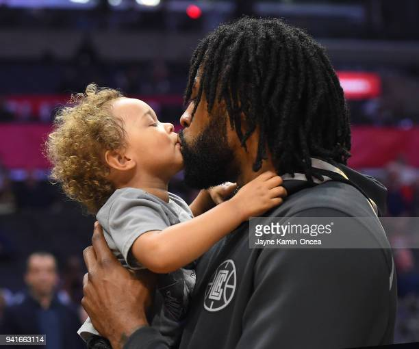 DeAndre Jordan of the Los Angeles Clippers holds his twoyearold son Jaden Jordan before the game against the San Antonio Spurs at Staples Center on...