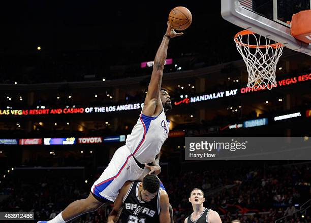 DeAndre Jordan of the Los Angeles Clippers is fouled by Tim Duncan of the San Antonio Spurs on an attempted dunk at Staples Center on February 19...