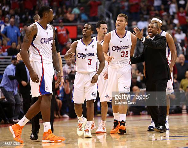 DeAndre Jordan of the Los Angeles Clippers is intercetped by Chris Paul Blake Griffin and head coach Doc Rivers after Jordan got in an altercation...