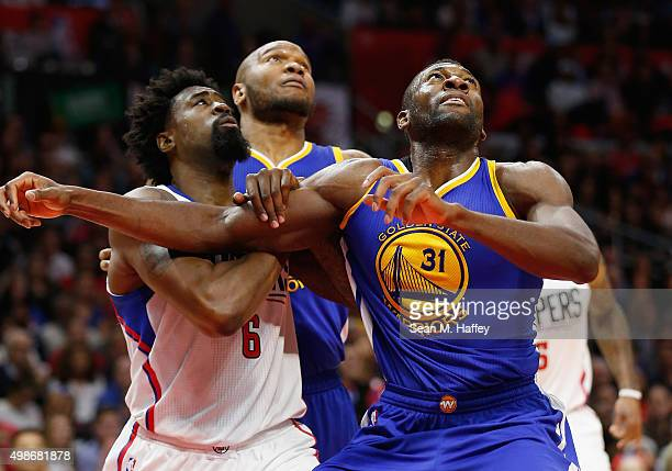 DeAndre Jordan of the Los Angeles Clippers Marreese Speights of the Golden State Warriorsand Festus Ezeli of the Golden State Warriors battle for...