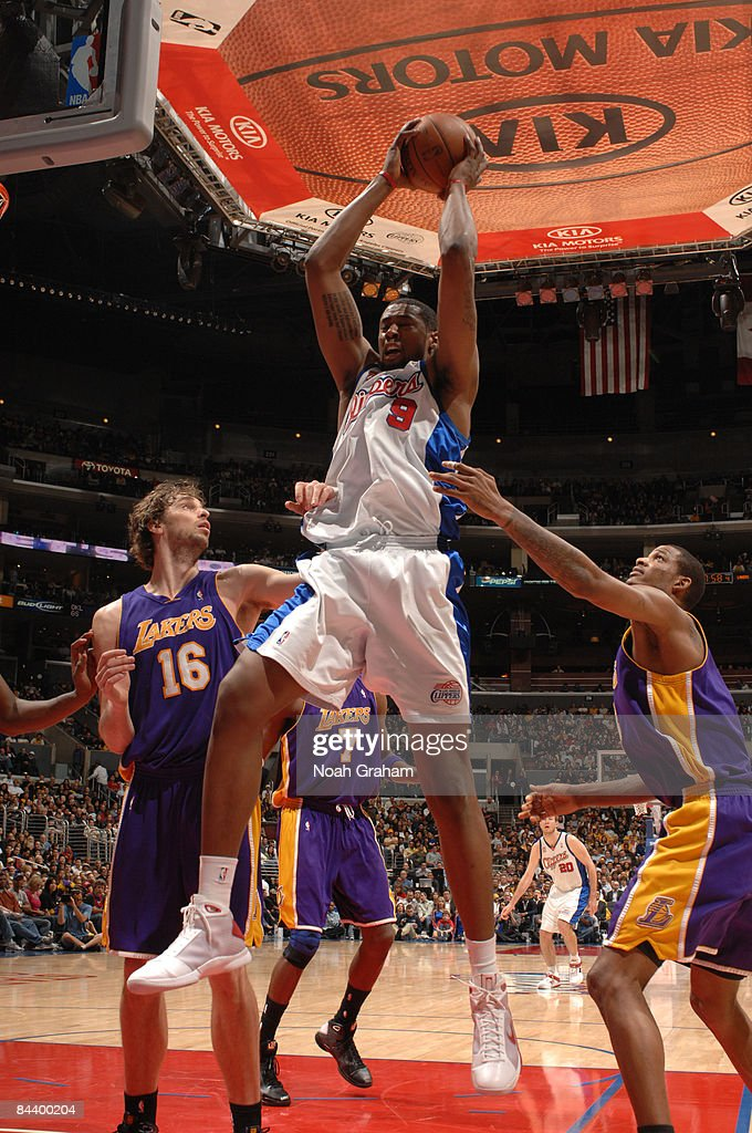 DeAndre Jordan #9 of the Los Angeles Clippers pulls down a rebound between Pau Gasol #16 and Trevor Ariza #3 of the Los Angeles Lakers at Staples Center on January 21, 2009 in Los Angeles, California.
