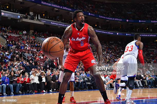 DeAndre Jordan of the Los Angeles Clippers reacts after dunking the ball against the Philadelphia 76ers at Wells Fargo Center on March 27 2015 in...