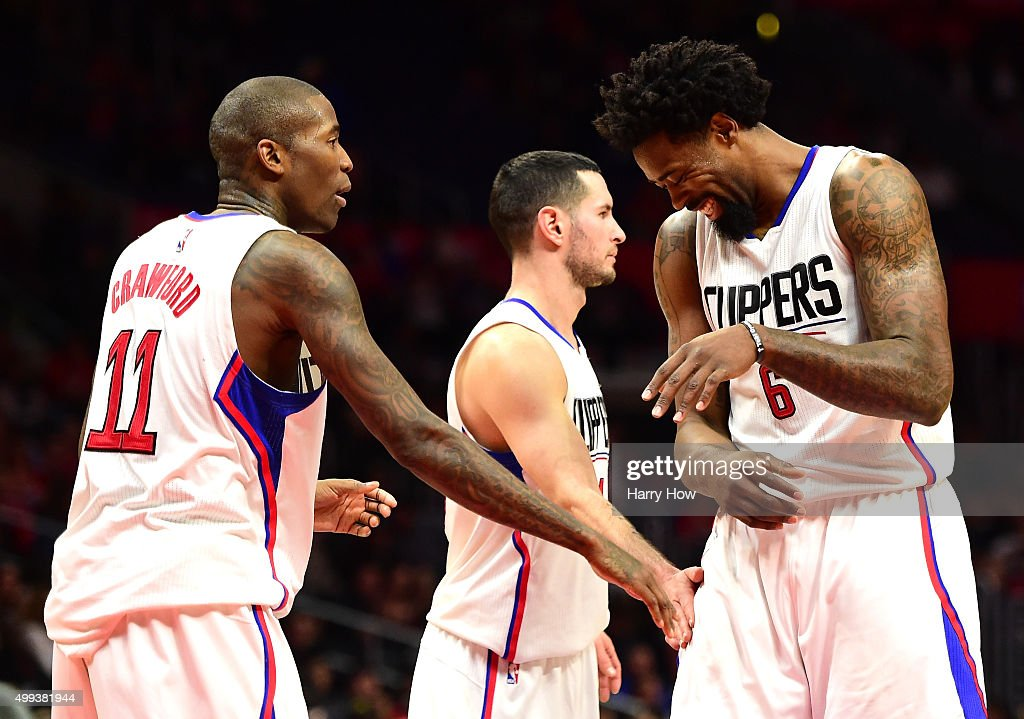 DeAndre Jordan #6 of the Los Angeles Clippers reacts after making a free throw as Jamal Crawford #11 and J.J. Redick #4 give him a pat during a 102-87 Clipper win over the Portland Trail Blazers at Staples Center on November 30, 2015 in Los Angeles, California.