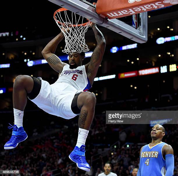 DeAndre Jordan of the Los Angeles Clippers scores on a dunk in front of Randy Foye of the Denver Nuggets during a 110103 Clipper win at Staples...