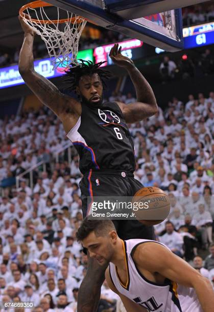 DeAndre Jordan of the Los Angeles Clippers scores over the defense of Raul Neto of the Utah Jazz in the second half of the Clippers 9893 win in Game...