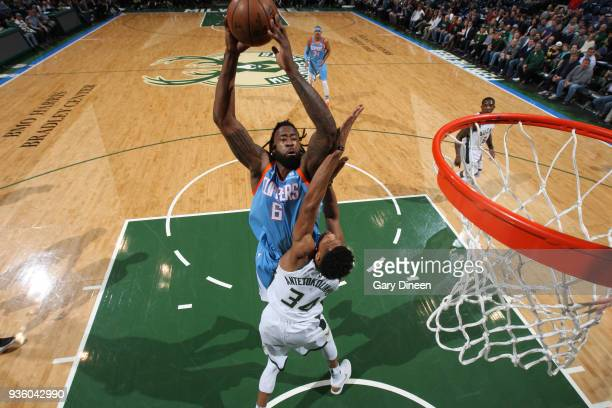 DeAndre Jordan of the Los Angeles Clippers shoots against Giannis Antetokounmpo of the Milwaukee Bucks during the NBA game on March 21 2018 at the...