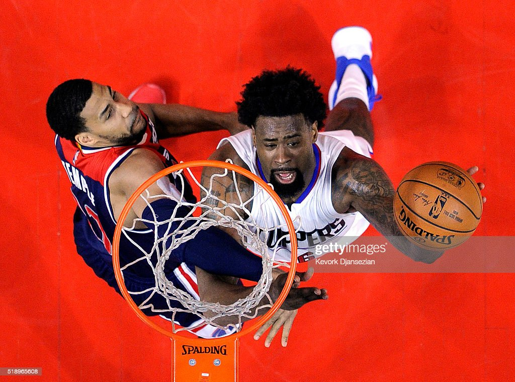 DeAndre Jordan #6 of the Los Angeles Clippers shoots over Garrett Temple #17 of the Washington Wizards during the first half of the basketball game at Staples Center April 3, 2016, in Los Angeles, California.