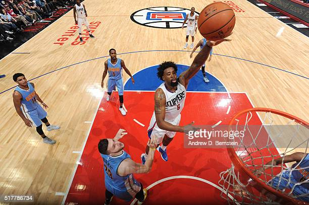 DeAndre Jordan of the Los Angeles Clippers shoots the ball against the Denver Nuggets on March 27 2016 at STAPLES Center in Los Angeles California...
