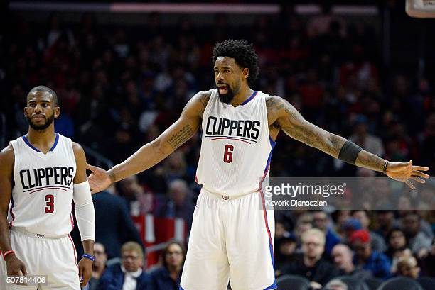 DeAndre Jordan of the Los Angeles Clippers talks with teammate Chris Paul during the second half of the basketball game against Chicago Bulls at...