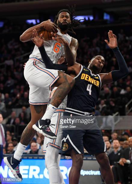 DeAndre Jordan of the New York Knicks attempts a basket during the first half of the game against the Denver Nuggets at Madison Square Garden on...