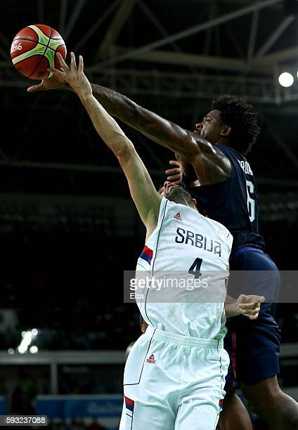 DeAndre Jordan of United States blocks a shot by Milos Teodosic of Serbia during the Men's Gold medal game on Day 16 of the Rio 2016 Olympic Games at...