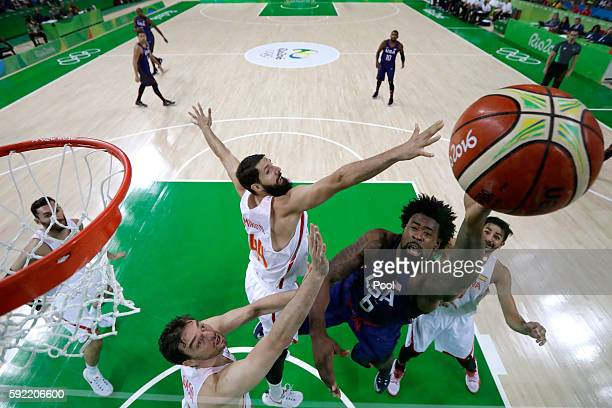 DeAndre Jordan of United States goes to the basket against Nikola Mirotic and Pau Gasol of Spain during the Men's Semifinal match on Day 14 of the...