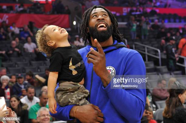 DeAndre Jordan spends a moment with his son before a basketball game between the Los Angeles Clippers and the Boston Celtics at Staples Center on...