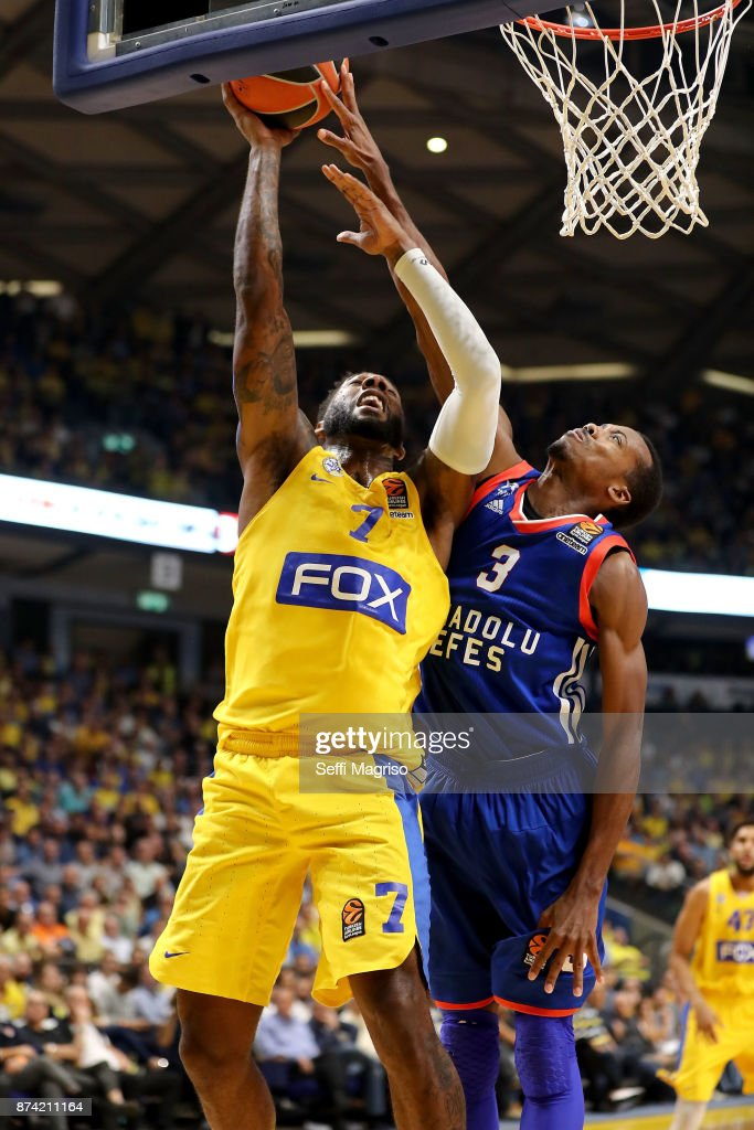 Deandre Kane, #7 of Maccabi Fox Tel Aviv competes with Errick McCollum, #3 of Anadolu Efes Istanbul during the 2017/2018 Turkish Airlines EuroLeague Regular Season Round 7 game between Maccabi Fox Tel Aviv and Anadolu Efes Istanbul at Menora Mivtachim Arena on November 14, 2017 in Tel Aviv, Israel.