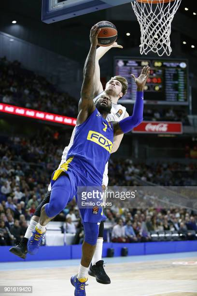 Deandre Kane #7 of Maccabi Fox Tel Aviv competes with Luka Doncic #7 of Real Madrid during the 2017/2018 Turkish Airlines EuroLeague Regular Season...