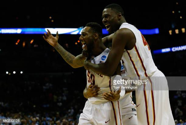 DeAndre Kane and Daniel Edozie of the Iowa State Cyclones celebrate after defeating the North Carolina Tar Heels 85-83 in the third round of the 2014...