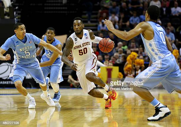 DeAndre Kane of the Iowa State Cyclones brings the ball up the court as Marcus Paige of the North Carolina Tar Heels defends during the third round...