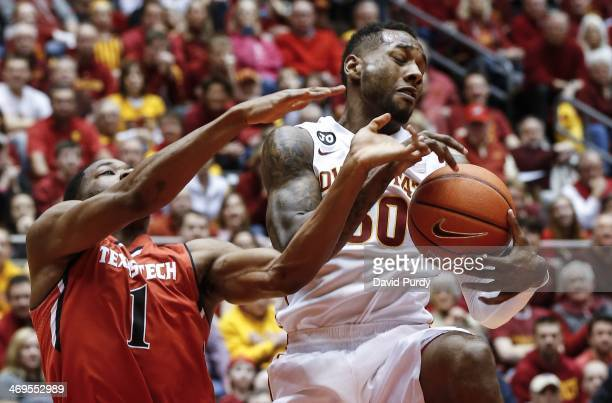 DeAndre Kane of the Iowa State Cyclones fights of a rebound with Randy Onwuasor of the Texas Tech Red Raiders in the second half of play at Hilton...