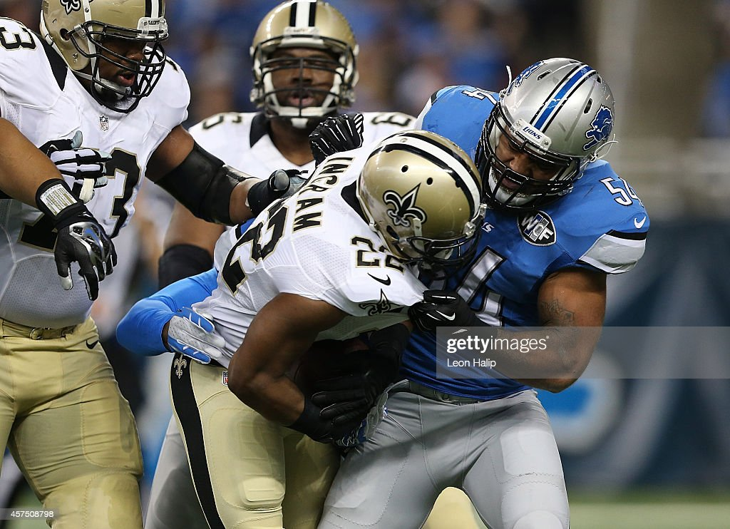 DeAndre Levy #54 of the Detroit Lions sacks Mark Ingram #22 of the New Orleans Saints during the first quarter of the game Ford Field on October 19, 2014 in Detroit, Michigan. The Lions defeated the Saints 24-23.