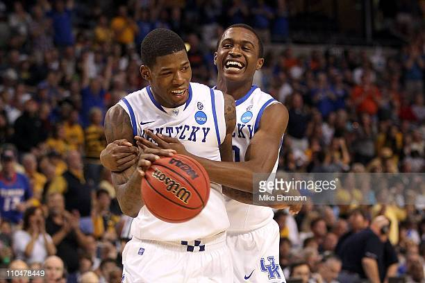 DeAndre Liggins and Doron Lamb of the Kentucky Wildcats celebrate after they won 7163 against the West Virginia Mountaineers during the third round...