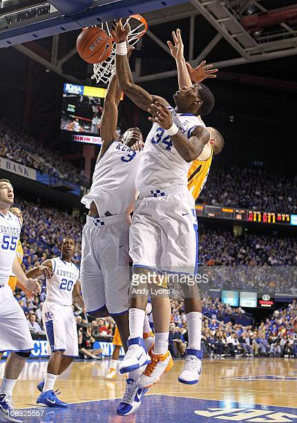 DeAndre Liggins and Terrence Jones of the Kentucky Wildcats reach for a rebound during the SEC game against the Tennessee Volunteers at Rupp Arena on...