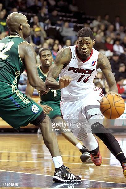 DeAndre Liggins from the Sioux Falls Skyforce drives against Bryan Davis from the Reno Bighorns in their NBA DLeague game November 22 2013 at the...