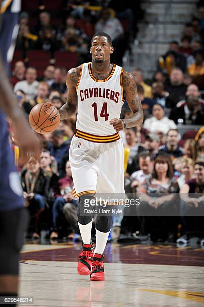 DeAndre Liggins of the Cleveland Cavaliers brings the ball up court against the Memphis Grizzlies during the game on December 13 2016 at Quicken...