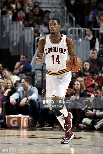 DeAndre Liggins of the Cleveland Cavaliers brings the ball up court during the game against the New Orleans Pelicans on January 2 2017 at Quicken...