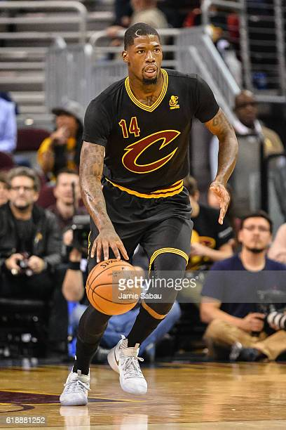 DeAndre Liggins of the Cleveland Cavaliers controls the ball against the New York Knicks on October 25 2016 at Quicken Loans Arena in Cleveland Ohio...