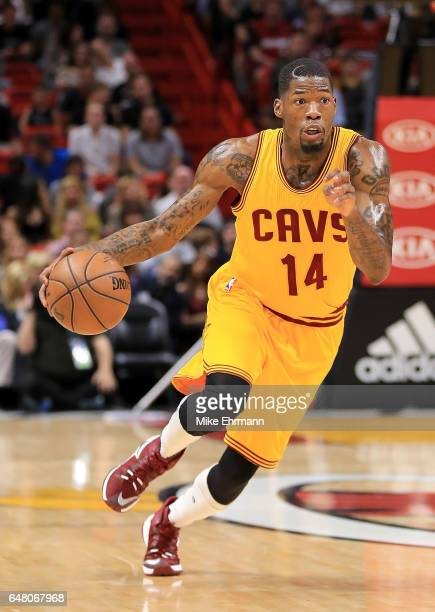 DeAndre Liggins of the Cleveland Cavaliers drives to the basket during a game against the Miami Heat at American Airlines Arena on March 4 2017 in...