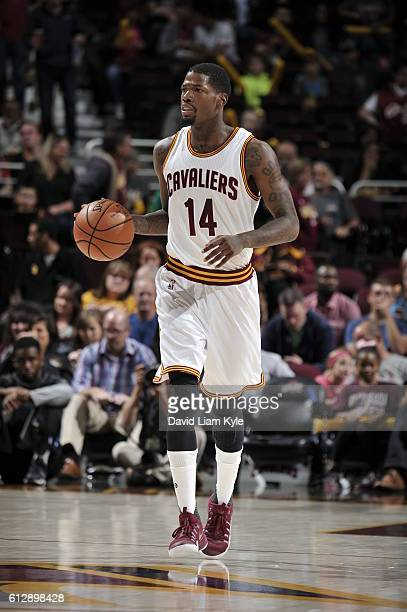 DeAndre Liggins of the Cleveland Cavaliers handles the ball against the Orlando Magic on October 5 2016 at Quicken Loans Arena in Cleveland Ohio NOTE...