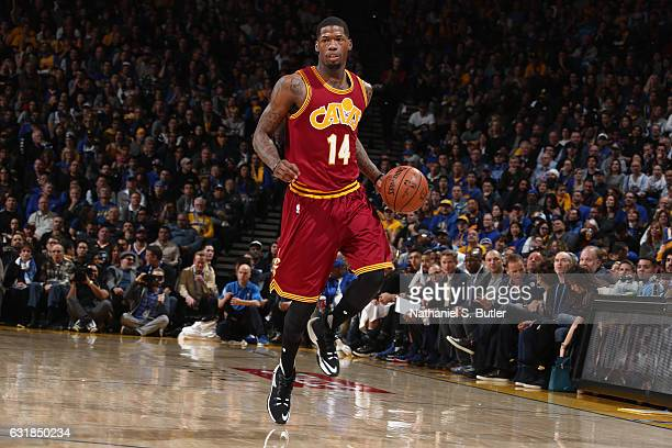 DeAndre Liggins of the Cleveland Cavaliers handles the ball against the Golden State Warriors on January 16 2017 at ORACLE Arena in Oakland...