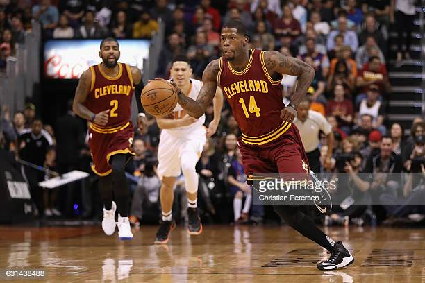 DeAndre Liggins of the Cleveland Cavaliers handles the ball during the first half of the NBA game against the Phoenix Suns at Talking Stick Resort...